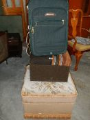 Two foot stools and a suitcase.