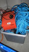 A battery charger and a quantity of rope.