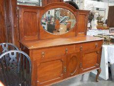 An Edwardian mahogany mirror back sideboard.