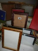 A quantity of picture frames.