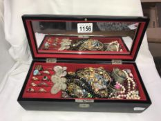 A musical jewellery box containing costume jewellery