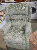 A reclining arm chair in good condition.