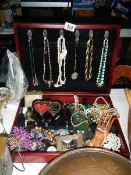 A mixed lot of costume jewellery in box.