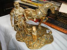 A solid brass figure of a blacksmith.