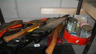 A shelf of saws, axes etc.