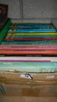 A large quantity of old car manuals.