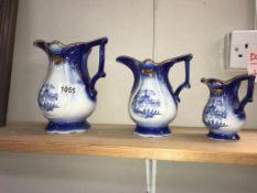 A set of 3 graduated blue Staffordshire pottery jugs