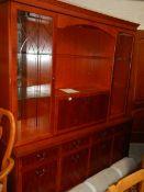 A mahogany unit with cut glass doors.