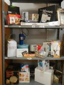 Three shelves of boxed items.