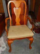 A Queen Anne style elbow chair.