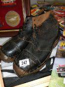 A pair of vintage steel toecap boots.