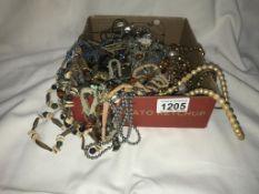 A mixed lot of vintage pendants & necklaces