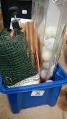 A box of table tennis items including net, balls, bats etc.