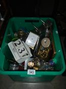 A box of miscellaneous including clock.