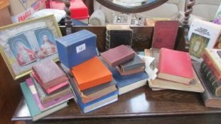 A quantity of bibles and other religious books.