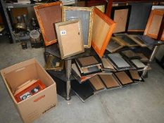 A large lot of photo frames.