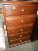 A five drawer chest.