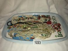 A mixed lot of pearl & other necklaces