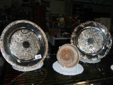 Two silver plate card trays and a silver plate decanter coaster.