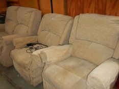 A three piece suite with recliner.