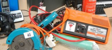 A quantity of tools including battery charger etc.