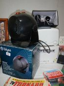 A boxed Blyss heater and other items.