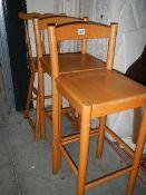 Three pine kitchen stools.