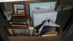 A large box of assorted pictures.