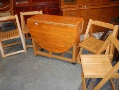 A pine kitchen table and 4 chairs.