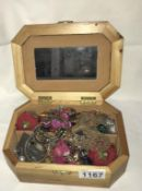 A wooden jewellery box of rings & earrings