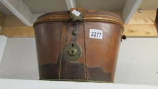 An old leather top hat case.