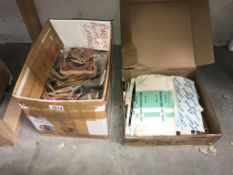 A large quantity of beer mats & quantity of cigarette boxes & wrappers