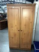 A pine effect 2 door wardrobe,