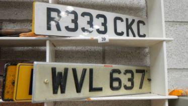 A quantity of car number plates.