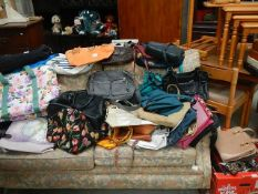 A good lot of hand bags including Kipling,