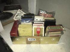 Approximately 18 packs of vintage playing cards including novelty & Lexicon etc.
