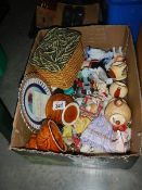 A box of ceramic collectables.