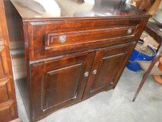 A mahogany cabinet.