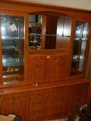 A teak effect glazed cabinet.