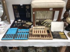 9 boxed sets of cutlery,