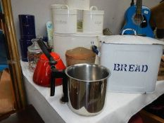 A quantity of metal kitchen ware.