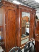 A Victorian mahogany break front wardrobe with fully fitted interior.