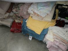 A large lot of blankets and curtains.