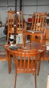 A teak dining table and four chairs.