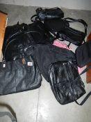 A quantity of hand bags etc.