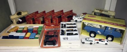 A boxed tonka mini Tonka tow truck & a quantity of unboxed die cast cars etc.
