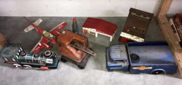A selection of large play worn tin plate toys in various conditions