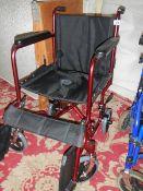 A four wheeled walking aid.
