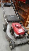 A Honda HR216 petrol mower.