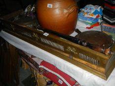 An old brass fire fender and 2 part warming pans.